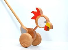 Wooden eco-friendly push toy - Chicken. The item is a great gift idea. This beautiful wooden chicken is completelly handmade. It is crafted of eco wood, durable and safe for your child, because colored with safe acrylic paints and covered with non-toxic varnish. DIMENTION: STICK:
