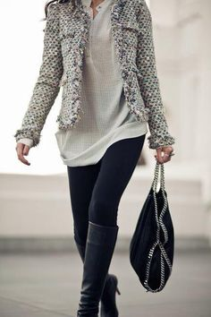 I like this:  look at the varying length of layers, as well as contrasting weights/textures.  Simple:  T, Leggings, Tall Boots, Statement Jacket=CHIC!