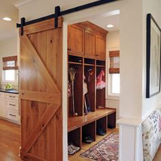 Change the door style to your taste.  It's a great way to provide separate from the rear-entry foyer.