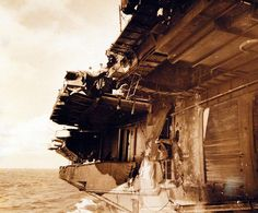 80-G-270733: Damage resulting from crash of Japanese plane into the flight deck of USS Essex (CV 9), 25 November 1944.