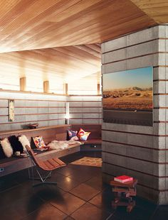 Modern home renovation in Napa includes redwood and concrete living room with built-in bench