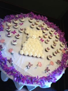 Cake dress with surrounding butterflies - purple bling and butterfly themed wedding shower.