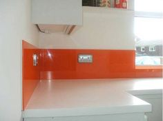 White Kitchen Orange Splashback orders please – this café-style kitchen features a bronze-tinted