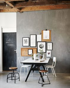 Industrial living room / dining room with picture frames, wooden stools, white chairs, a folding table and botanic plants Industrial Living, Industrial Interiors, Rustic Industrial, Industrial Workspace, Industrial Closet, Industrial Bookshelf, Industrial Flooring, Industrial Apartment, Industrial Bedroom