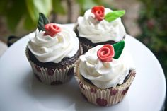 cupcakes with raspberry and chocolate ganache topped with a chocolate rose