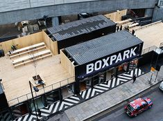 Nice concept for a temporary contemporary architecture projects: Pop-Up-Stores builded by using shipping containers spreaded over two levels.