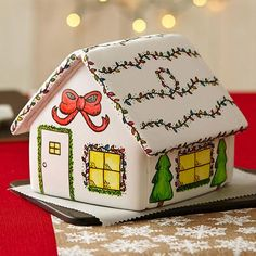 Painted Christmas Gingerbread House - This season, create a winterrific Christmas gingerbread house with panels that are covered with thinned royal icing, painted with Icing Colors and accented with FoodWriter Edible Color Markers. Have fun building the house using cookie panels and icing included in our Unassembled Gingerbread Cottage Kit.