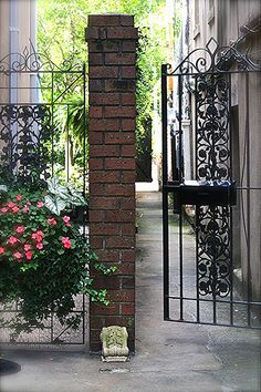 Wrought iron gateway into a garden in one of the beautiful homes in Savanah, Georgia. Gates And Railings, Wrought Iron, Beautiful Homes, Georgia, Arch, Sidewalk, Outdoor Structures, Garden, House Of Beauty