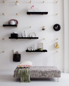 pegs on a grid means  you can move your shelves around anywhere you want.  clever.
