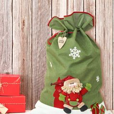 Our Luxury Festive Green Santa Sack with Name Tag is a fantastic treat to give to someone special this Christmas Made from the most scrumptious raw