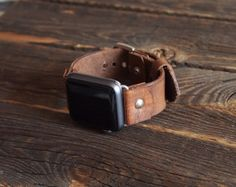 Unconventionally stylish Button-Stud Apple Watch band The design is simple yet… Apple Band, Apple Watch Bands, Vegetable Tanned Leather, Buy And Sell, Watches, Button, Stylish, Simple, Handmade