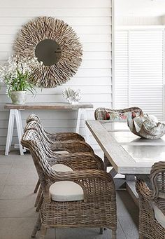 Rattan furniture and white cladding are great for a beach house look