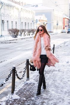20 Ways to Wear Colorful Fur - dramatic pink fur scarf worn over a white sweater, black mini skirt + sheer tights and knee high black boots