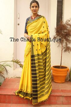 Beautiful yellow and black color combination linen saree with small tassels . 15 July 2017