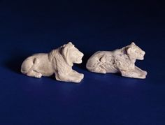 Lion gaming pieces, reign of King Djet, Abydos (ivory) Old Kingdom, 1st Dynasty, ca. 3150-2890 BC, lion 7.1x4.8, lioness 7x3.6. Now at the Fitzwilliam Museum, University of Cambridge.