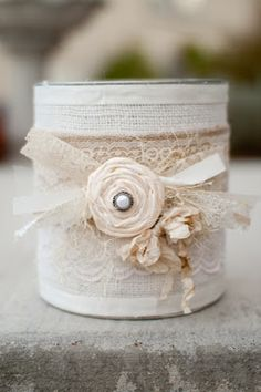 Another Burlap + Tin Can....these would be pretty highlighting some outdoor pictures of the bride and groom taken in a meadow where the wedding would take place.