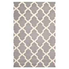 Create a captivating focal point in your living room or foyer with this eye-catching design, an enviable addition to your home d�cor.   Product: RugConstruction Material: WoolColor: Silver and ivoryFeatures:  Made in IndiaHand-tufted Note: Please be aware that actual colors may vary from those shown on your screen. Accent rugs may also not show the entire pattern that the corresponding area rugs have.Cleaning and Care: Professional cleaning recommended