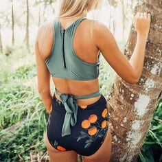 The Castaway is our newest take on our ever popular cut-out. We've color blocked the front with our original citrus Grove print to create the illusion of a high waisted bottom. This swimsuit lengthens