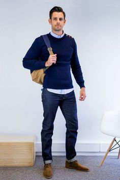 For an everyday outfit that is full of character and personality consider teaming a navy crew-neck sweater with deep blue jeans. Brown suede chukka boots are a great choice to complete the look. Shop this look on Lookastic: https://lookastic.com/men/looks/crew-neck-sweater-long-sleeve-shirt-jeans/21638 — Light Blue Long Sleeve Shirt — Navy Crew-neck Sweater — Navy Backpack — Navy Jeans — Brown Suede Desert Boots