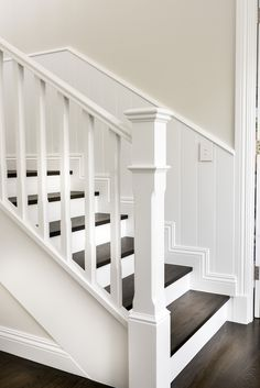Warm inviting and perfect for a busy family this elegant home brings a softer House Stairs brings busy Elegant Family home Inviting Perfect softer Warm Staircase Banister Ideas, White Staircase, Stair Railing Design, House Staircase, Staircase Remodel, Modern Staircase, Banisters, White Banister, Wooden Railing Stairs