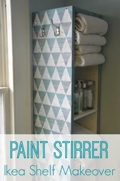This plain set of Ikea white shelves got a fun makeover for free using paint stirrers and craft paint.