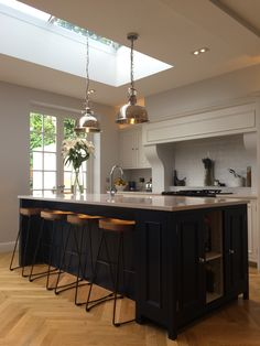 Neptune Chichester kitchen with Navy Blue Island. French Oak solid wood parquet flooring. French solid timber double doors.