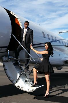 """THEMES: We are having a destination wedding so why not theme that into your engagement photos? Our tag line """"Jet away with us"""" great for save the dates!!! Dress:Ted Baker Shoes:Christian louboutin Suit:Custom Tie:Burberry Shoes:Aldo. Photo, MU, Hair all by Michael Franco"""