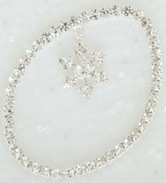 4 Snowflake Charm Bracelets by Gordon Companies, Inc. $81.00. This product may be prohibited inbound shipment to your destination.. Picture may wrongfully represent. Please read title and description thoroughly.. Please refer to SKU# ATR25774575 when you inquire.. Shipping Weight: 5.00 lbs. Brand Name: Gordon Companies, Inc Mfg#: 30710390. 4 Snowflake Charm Bracelets/7.5''L/made of metal and man-made materials/individually gift boxed/you get 4 of the bracelet shown