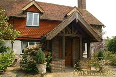 Oak Porches - 867: Decorative oak frame porch. A beautifully designed oak frame porch compliments the entrance to this country cottage.