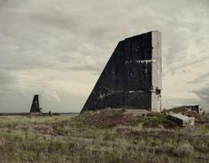 "although not technically conflict, the Kurchatov nuclear testing site in the Polygon of Kazakhstan is a proponent of war, and photographer Nadav Kander captured haunting photos in his series called ""Dust"". Polygon Nuclear Test Site I, 2011 Nuclear Test, Haunting Photos, Kazakhstan, Brutalist, Grafik Design, Cold War, Abandoned Places, Abandoned Buildings, Les Oeuvres"