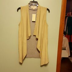 MICHAEL Michael Kors Suede Vest Never been worn. Purchased from Macy's. 100% Goat suede. XS seems to fit those who are a small or medium. The suede is khaki colored. No trades or PayPal on any items. Please read closet rules. Added: 11/20/15 price dropped: 2/9/16 MICHAEL Michael Kors Tops