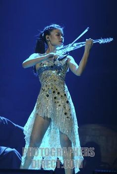 Vanessa Mae portrait of the Singapore born British pop and classical violinist playing the electric violin at the Classical Brit Awards , 20...