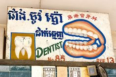 hand painted cambodian dentist sign