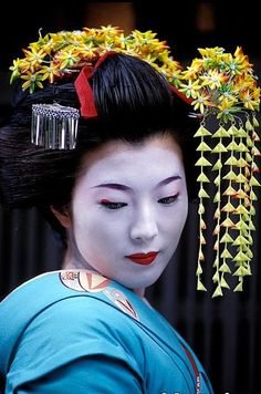 A Maiko - Kyoto, Japan A Maiko is an apprentice Geisha. Maiko's originally only served tea and dumplings in the tea houses of Kyoto. Now, they also perform songs, dances, and play instruments during...
