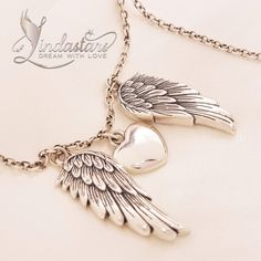 My Heart Guided By Angels necklace - A dainty heart pendant, embraced between a pair of angel wings, symbolizes the consecrated presence of angels in our lives. This pendant serves as a talisman for achieving your dreams and its dazzling looks makes you feel fabulous on the way towards them.