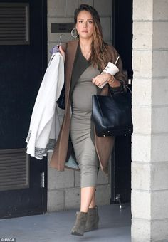 Looking sensational: Jessica Alba, 36, showed off her blossoming baby bump in a form-fitting olive green Michael Stars dress when she enjoyed an afternoon out in Los Angeles on Monday