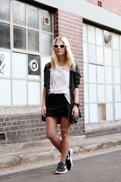 what-do-i-wear:    Acne tee, Amy Kaehne jacket, Eska Alikai leather skirt, Nike sneakers from Platypus Shoes in Bondi Junction, Nick Campbell sunglasses, Nixon watch (image: wethepeoplestyle)