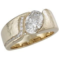 An organically shaped modern engagement ring that is contoured to a variety of stone shapes.  Channel-set diamonds add extra sparkle.  The stone is flush set to the band, which thickens toward the top of the finger to allow for the depth of the stone.  Width is dependent on the size of the stone.  0.12 ctw ideal cut accent diamonds. - This modern engagement ring has a large oval diamond. The handcrafted yellow gold mounting is hammered for some texture.