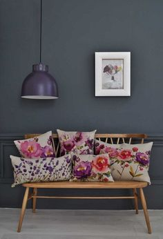 love this bench for an entryway and the idea of putting floral pillows on it.