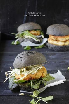 Wow your guests by whipping up your own burger buns and giving them a fun boost with squid ink (perfect for Halloween, if you ask me). Spicy halibut patties paired with fabulous Asian flavours really elevate this dish. A serious crowd pleaser! Burger Recipes, Fish Recipes, Yummy Recipes, Tasty Burger, Good Food, Yummy Food, Burger Buns, Halibut, Wrap Sandwiches
