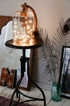 Super Cozy Ways To Use String Lights In Your Home Put a battery-powered strand of string lights in a bell jar for an artsy DIY light.Put a battery-powered strand of string lights in a bell jar for an artsy DIY light. The Bell Jar, Bedroom Lighting, Home Lighting, Lighting Ideas, Apartment Lighting, Balcony Lighting, Lighting Stores, Modern Lighting, Lighting Design