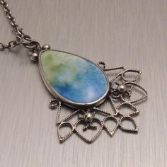 Enamel and Silver Filigree Pendant in Blue and by Copperheart, $149.00
