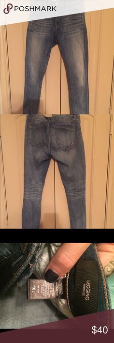 Express legging jeans-Longs Mid Rise Medium Wash Jean Legging  Have been dry cleaned only!!  This jean's classic wash and slightly stretchy, close-to-the-body fit gives you a smooth, sexy look that stands the test of time. Pair it with a tucked-in graphic tee or fitted bodysuit for effortlessly cool, casual style.  Mid rise jean legging One button closure with zip fly; Five pocket styling Whiskering, fading Medium wash Cotton/Polyester/Spandex Express Jeans Skinny