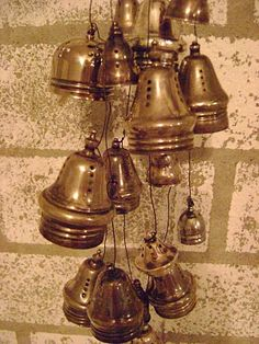 wind chime....orphaned salt and pepper tops became the chimes.....it makes such a wonderful delicate sound!