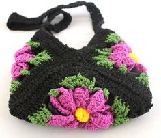 cute handbag... looks like it just uses 3 granny squares!