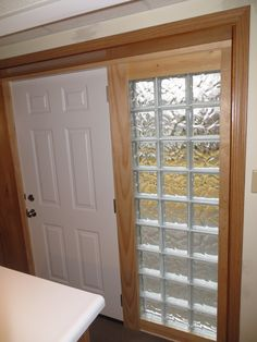 The after shot showing a new steel entry door with glass block sidelight. & Wood door with glass block windows. I have always loved glass brink ...