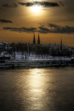 Sun setting behind church in downtown, Helsinki, Finland