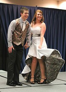 White and camo hi low wedding dress- camo on the inside of the dress!! hahahaha that is awesome!!!