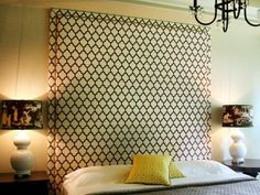 Create a dramatic focal point in your bedroom with a custom, upholstered headboard that extends to the ceiling.