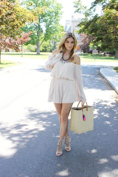 Neutral summer romper from TOBI #shoptobi Market tassel bag, nude fringed heels, statement necklace from Shop the Exhibit